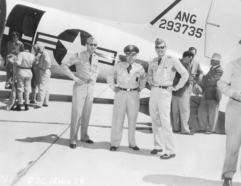 National Guard leaders on the ramp at Gowen Field, Idaho, June, 18 1954.  Left to right are an unidentified field grade officer with what may be the 41st Infantry Division emblem on his shoulder, Col. Frank W. Frost, Commander of the 142nd Fighter-Interceptor Wing, and Brig. Gen. G. Robert Dodson, Commander of the Oregon ANG.  (Courtesy 142FW History Archives)