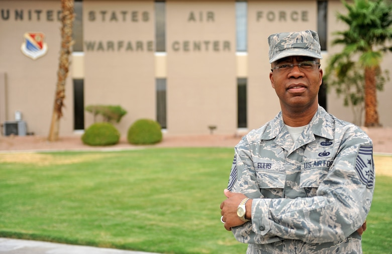 Chief Master Sgt. Robert A. Ellis, U.S. Air Force Warfare Center command chief, poses for a photo outside of the U.S. Air Force Warfare Center headquarters building at Nellis Air Force Base, N.V., July 16, 2014. Ellis, who will be retiring after serving 30 years in the Air Force, has held various duties ranging from squadron to major-command level. His stateside assignments include bases in South Dakota, Nevada, Arizona, Texas, Virginia and Colorado. The Chief also served overseas in the United Kingdom, the Netherlands, Japan and Turkey, and has deployed in support of Operations Desert Shield, Allied Force and Enduring Freedom. (U.S. Air Force photo by Staff Sgt. Siuta B. Ika)