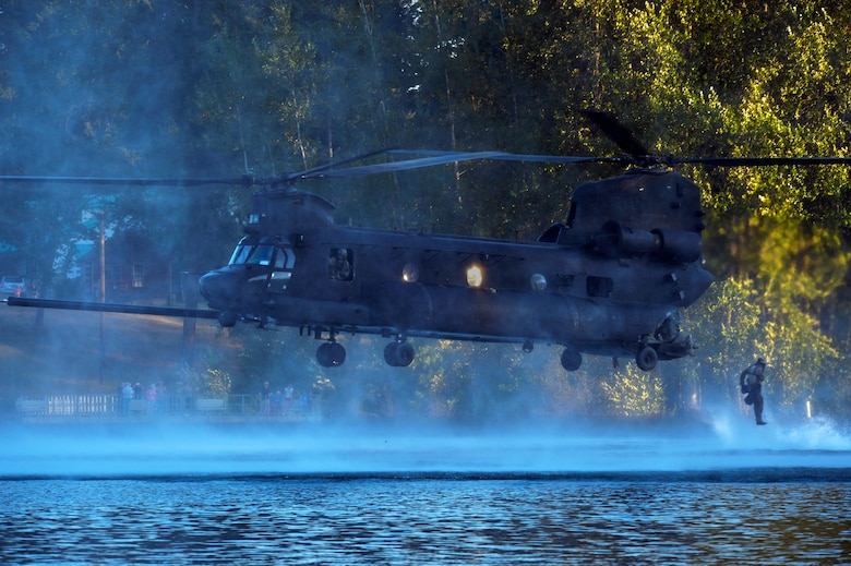 An Airman from the 22nd Special Tactics Squadron's Red Team jumps out of an MH-47 Chinook helicopter July 14, 2014, during helocast alternate insertion and extraction training with Soldiers from the 160th Special Operations Aviation Regiment at American Lake on Joint Base Lewis-McChord, Wash. The 160th SOAR was tasked with AIE training and called the 22nd STS in hopes their Airmen would have the training requirement to take part in the exercise. (U.S. Air Force photo/Staff Sgt.Russ Jackson)
