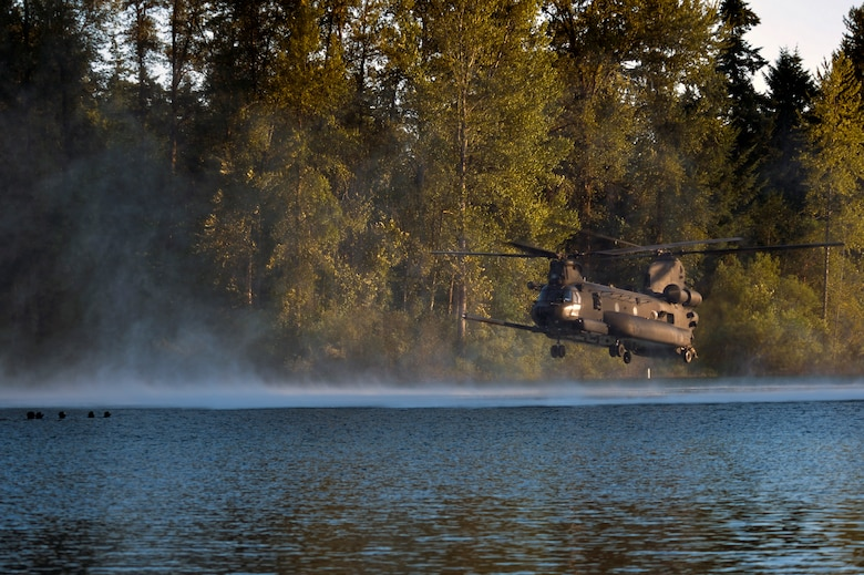 Airmen from the 22nd Special Tactics Squadron's Red Team wait in American Lake July 14, 2014, for an MH-47 Chinook helicopter to extract them during helocast alternate insertion and extraction training with Soldiers from the 160th Special Operations Aviation Regiment at Joint Base Lewis-McChord, Wash. Soldiers from the 160th SOAR needed the AEI training and called upon members of the 22nd STS for assistance. (U.S. Air Force photo/Staff Sgt.Russ Jackson)