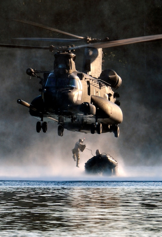 An Airman from the 22nd Special Tactics Squadron's Red Team jumps out of an MH-47 Chinook helicopter July 14, 2014, during helocast alternate insertion and extraction training with Soldiers from the 160th Special Operations Aviation Regiment at American Lake on Joint Base Lewis-McChord, Wash. The Airmen from the STS conducted 10 daytime helocast iterations and eight nighttime helocast iterations over a two-day span. (U.S. Air Force photo/Staff Sgt. Russ Jackson)