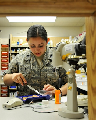 U.S. Air Force Capt. Jessica Shalita, 509th Medical Support Squadron pharmacist, counts controlled medications at Whiteman Air Force Base, Mo., June 18, 2014.  This procedure is done to ensure to ensure both the prescription count and remaining stock are accurate. (U.S. Air Force photo by Airman 1st Class Keenan Berry/Released)