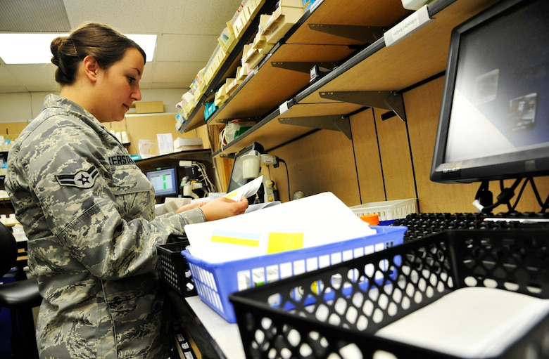 U.S. Air Force Airman 1st Class Kerstanoff, 509th Medical Support Squadron pharmacy technician, processes a patient's order at Whiteman Air Force Base, Mo., June 18, 2014.  This procedure is done to ensure each patient receives his/her prescribed medications. (U.S. Air Force photo by Airman 1st Class Keenan Berry/Released)