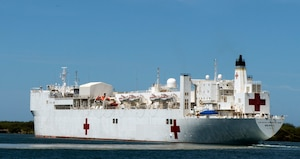The hospital ship USNS Mercy departs Pearl Harbor for Rim of the Pacific 2014, the world's largest international maritime exercise, July 15, 2014. U.S. Navy photo by Petty Officer 1st Class Charles E. White