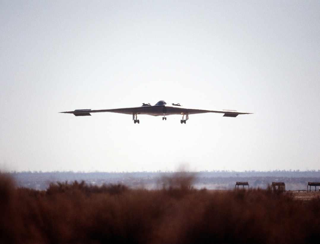 A B-2 Spirit bomber lines up on the runway July 17, 1989, at the Northrop Grumman production facility in Palmdale, Calif. The first flight was just over two hours long, and ended at Edwards Air Force Base, Calif, where the aircraft underwent further testing both on the ground and in the air. (Defense Imagery Management Operations Center)