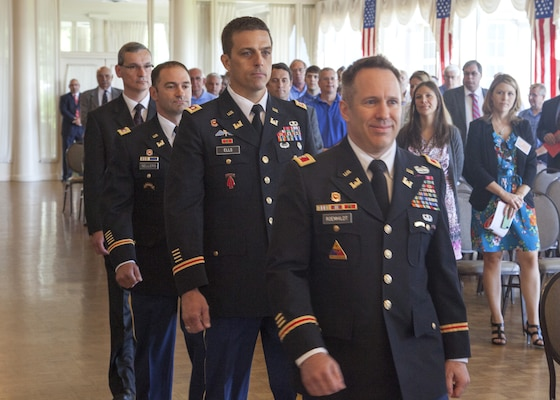 Col. Steven J. Roemhildt, Great Lakes and Ohio River division commander, leads the Offical procession party to the stage during the Detroit District change of command ceremony July 10, 2014; following him are Lt. Col. Robert J. Ells, the outgoing district commander, Lt. Col. Michael L. Sellers, the incoming district commander, and Scott Thieme, the deputy distict engineer for project management.