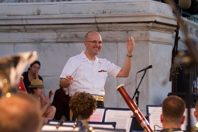 """On July 16, 2014, at the U.S. Capitol in Washington, D.C., 1st Lt. Ryan J. Nowlin conducted his first concert as an assistant director. The program include marches by John Philip Sousa and Henry Fillmore, Gustav Holst's Suite in F for Military Band, and Carmen Dragon's arrangement of Samuel Augustus Ward's """"America, the Beautiful."""" (U.S. Marine Corps photo by GySgt Amanda Simmons/released)"""