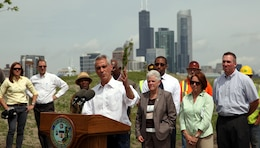Mayor Rahm Emanuel speaks at a press conference at the Corps' Northerly Island Ecosystem Restoration Project site, Chicago, June 17, 2014. At right, Gina McCarthy, Environmental Protection Agency administrator; Jo-Ellen Darcy, Assistant Secretary of the Army (Civil Works); Michael Kelly, Chicago Park District superintendent. (U.S. Army Photo by Sarah Gross/Released)
