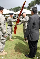 Lt. Col. Christopher W. Crary (second from right) accepts the command colors from Pacific Ocean Division Commander Maj. Gen. Richard L. Stevens during a military ceremony held July 17 on Palm Circle parade field at Fort Shafter, Hawaii. Crary is the 69th commander of the U.S. Army Corps of Engineers Honolulu District. At left is outgoing District Commander Lt. Col. Thomas D. Asbery and Tony Paresa, Deputy District Engineer for Programs and Project Management.