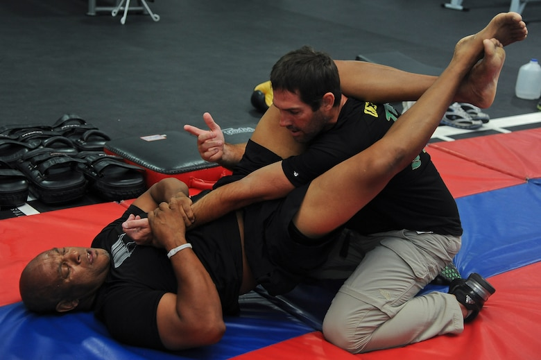 Team Ill Brasil brings a new style of martial arts to the base. The Luke Air Force Base Bryant Fitness Center now offers discipline specific martial arts training Monday through Friday at the Combat Training Center. (U.S. Air Force photo/Airman 1st Class Pedro Mota)
