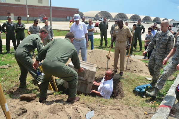 From left) Col. Thomas Shank, commanding officer of the 479th Flying Training Group (FTG), Navy Capt. Mike Fisher, retired Lt. Cmdr. Lee Wright, retired Navy Capt. Dan Hansen and NASP CO Capt. Keith Hoskins excavate a time capsule placed 20 years ago by search and rescue helicopter squadron HC-16. (Photo by Mike O'Connor)
