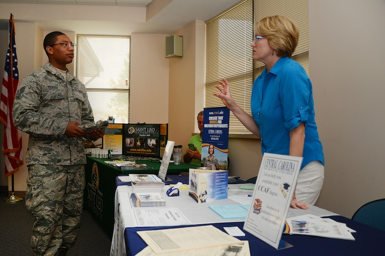 U.S. Air Force Staff Sgt. Eric Richard, assigned to the 169th Fighter Wing, receives education information from Carolyn Adamczyk, a military programs coordinator for Central Carolina Technical College at an education fair on McEntire Joint National Guard Base, S.C. July 12, 2014.  The 169th Fighter Wing sponsored the education fair to encourage Airmen to progress with their technical degree.   (U.S. Air National Guard photo by Airman 1st Class Ashleigh S. Pavelek/Released)