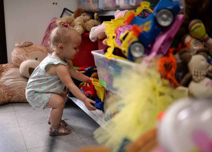 Loralei, daughter of U.S. Air Force Staff Sgt. Justin Blakeman, 52nd Component Maintenance Squadron and native of Gonzales, La., selects a toy July 15, 2014, from the children section of the Airman's Attic at Spangdahlem Air Base, Germany. The Attic collects donations from base members and redistributes them at no cost to service members. However, a recent influx of donations to the Attic has forced the staff to recycle nearly 1,000 pounds of toys, dishware, electronics and books a month. (U.S. Air Force photo by Staff Sgt. Daryl Knee/Released)