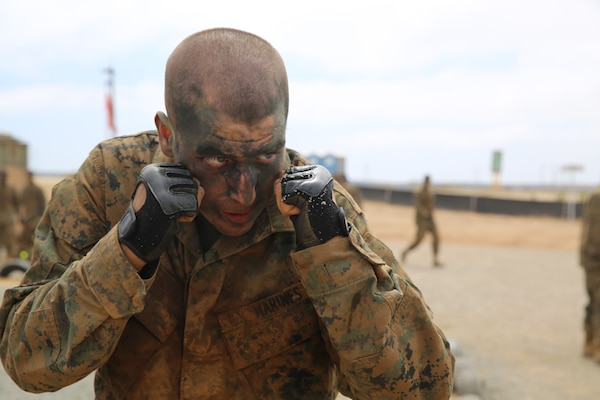 Marine Corps Pvt. Alexander D. Klopfenstein stands in a basic warrior stance during the body sparring event of the Crucible at Edson Range, Marine Corps Base Camp Pendleton, Calif., July 1, 2014. U.S. Marine Corps photo by Cpl. Tyler Viglione