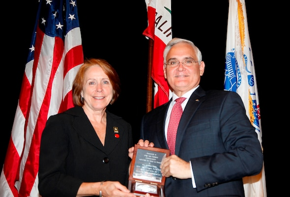The Honorable Jo-Ellen Darcy, Assistant Secretary of the Army (Civil Works) & Chair of PIANC USA, presents Mr. Jorge Quijano, Administrator, Panama Canal Authority, with a gift of thanks for his keynote speech.