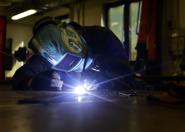 Airman 1st Class Daniel Gregory welds metal pieces July 9, 2014, on Aviano Air Base, Italy. The fabrication flight is responsible for fashioning tools, aircraft components and other support systems tailored to the F-16 Fighting Falcon. Gregory is a 31st Maintenance Squadron metals technology journeyman. (U.S. Air Force photo/Airman 1st Class Deana Heitzman)