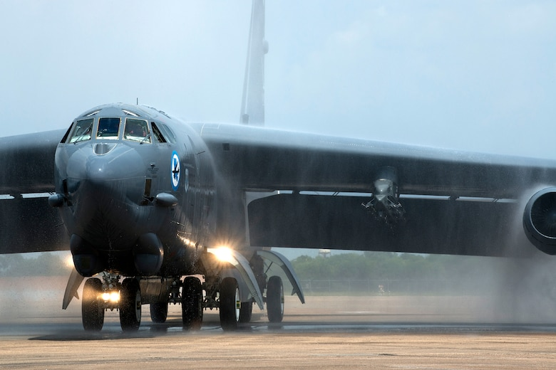 A 2nd Bomb Wing B-52H Stratofortress taxis under a spray of water after returning from a mission July 12, 2014, at Barksdale Air Force Base, La. This marked the last flight for one crewmember on the aircraft, Lt. Col. Ronald Polomoscanik, the 343rd Bomb Squadron director of operations, who is retiring after 23 years of service. (U.S. Air Force photo/Master Sgt. Greg Steele)