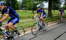 From left, Col. Thaddeus Chamberlain, Staff Sgt. Aaron Kirby and Airman 1st Class Shane Jochum train for an upcoming event July 16, 2014, on Joint Base Langley- Eustis, Va. All three are members of the Air Force cycling team and will participate in The Register's Annual Great Bicycle Ride Across Iowa, a week-long ride with a total distance of about 500 miles. (U.S. Air Force photo/Senior Airman Kayla Newman)