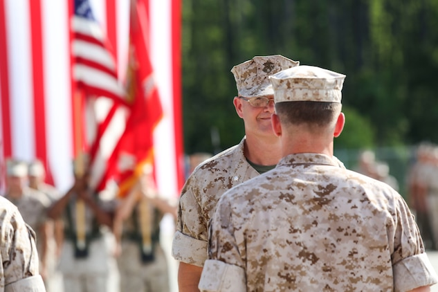 """Lt. Col. James B. Stone IV relinquished command of Marine Wing Support Squadron 273 to Lt. Col. Phillip J. Schendler aboard Marine Corps Air Station Beaufort, July 10. """"I've had a tremendous group of team players,"""" said Stone when asked about his time at MCAS Beaufort. """"Any successes I've had are the successes of the Marines here."""" MWSS-273 provides internal airfield communications, weather services, expeditionary airfield services, aircraft rescue and firefighting, aircraft and ground refueling, essential engineering services, motor transport, messing, chemical defense, security and law enforcement, airbase commandant functions, and explosive ordinance disposal."""