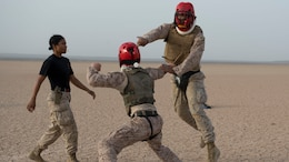 U.S. Marine Corps Sgt. Lawanda Ruiz, Combined Joint Task Force-Horn of Africa Personnel office administration chief, instructs Sgt. Bryan Mack (right) and Cpl. Steven Myint (middle) during the Marine Corps Martial Arts Program instructor's course final field exercise June 26, 2016, at Camp Lemonnier, Djibouti. Ruiz graduated seven students from the course. (U.S. Air Force photo by Staff Sgt. Leslie Keopka)