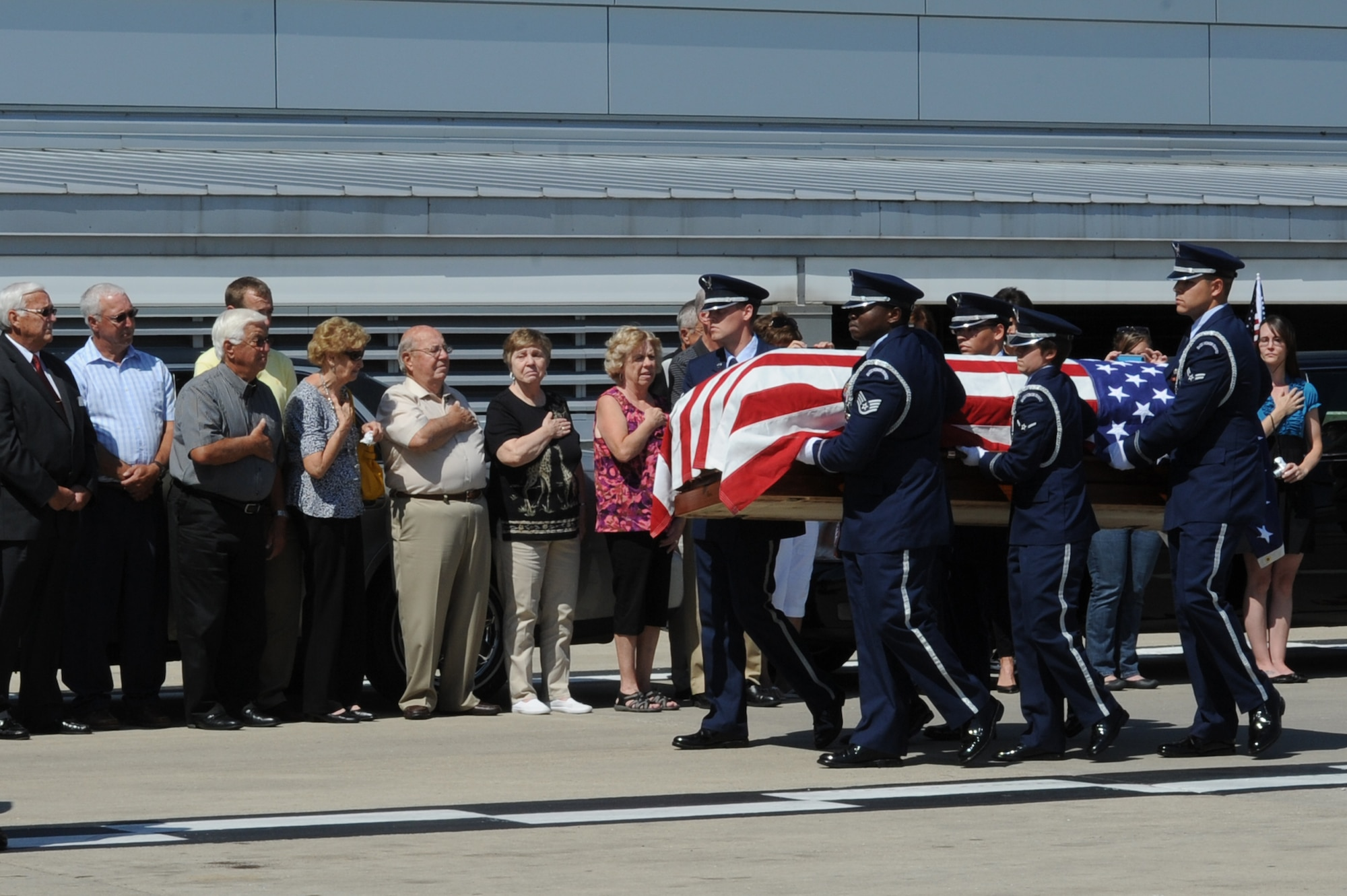 Members of the Scott Air Force Base Honor Guard transport the remains of Airman 3rd Class Howard Martin during a dignified arrival July 10, 2014, at the Indianapolis International Airport, Indiana. Martin died during a C-124 crash in 1952 and his remains were recovered earlier in 2014. (U.S. Air Force photo/Senior Airman Sarah Hall-Kirchner)