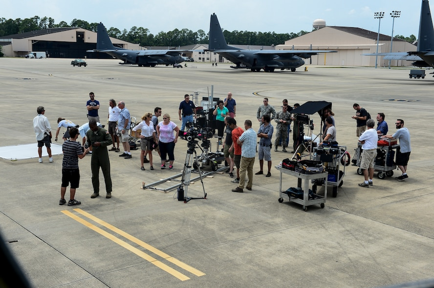 GSD&M Advertising crew set up their equipment prior to filming portions of an Air Force Recruiting commercial at Hurlburt Field, Fla., July 10, 2014. GSD&M Advertising is a company based out of Austin, TX and is contracted by the Air Force Recruiting Service to produce recruiting products. (U.S. Air Force photo/Airman 1st Class Jeff Parkinson)