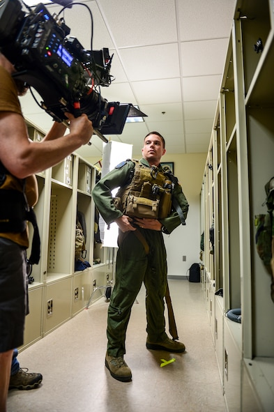 Capt. Chris Nehls, 8th Special Operations Squadron CV-22 pilot, dons his gear during the filming of an Air Force Recruiting commercial at Hurlburt Field, Fla., July 9, 2014. GSD&M Advertising is a company based out of Austin, TX contracted by the Air Force Recruiting Service. (U.S. Air Force photo/Airman 1st Class Jeff Parkinson)