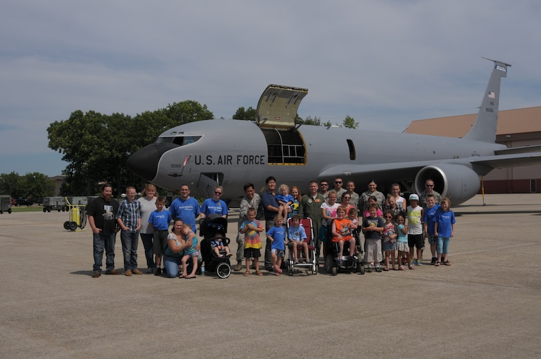 PEASE AIR NATIONAL GUARD BASE, N.H. – Make-a-Wish children and their families, along with members of the 157th Air Refueling Wing, pose for a group photo outside a KC-135 on the flightline here July 17. Eight children and their families were welcomed to Pease by Airmen who lined the sidewalk at the main gate, received demonstrations from the Dover Mounted Patrol and a Military Working Dog demonstration, enjoyed lunch at the Fire Department and toured the inside of a KC-135. (N.H. Air National Guard photo by Airman 1st Class Kayla McWalter/RELEASED)