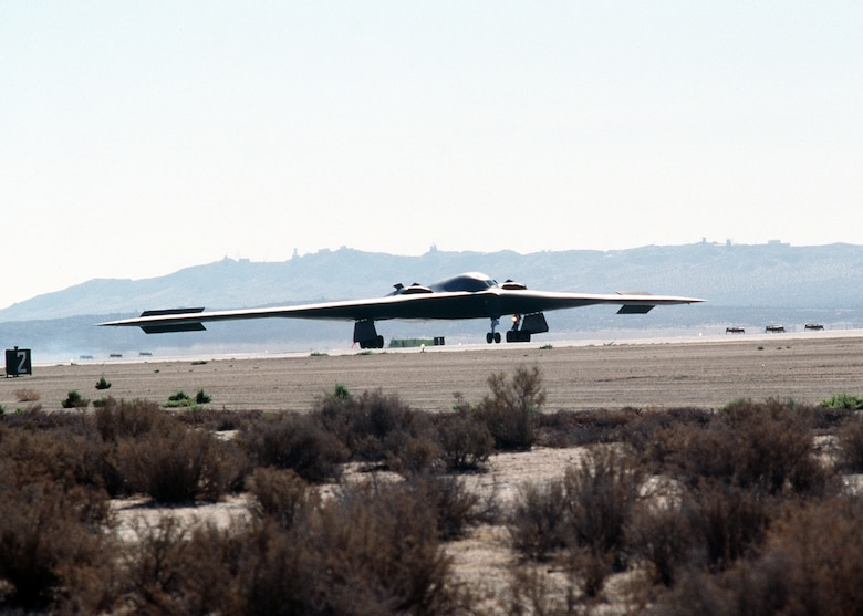 "On July 17, 1989, Bruce Hinds, Northrup Grumman chief test pilot, and Col. Richard Couch, B-2 combined test force director, flew the first B-2 mission in the skies above California. The two-hour, 20-minute flight took both pilots on a mission from Air Force Plant 42 in Palmdale, to Edwards Air Force Base.  Pictured here is a right front view of a B-2 bomber aircraft taxiing during its first test flight at the Air Force Flight Test Center, Edwards Air Force Base, California.  In December, 1993, the first B-2, the ""Spirit of Missouri,"" was delivered to Whiteman Air Force Base.  (photo by Rose Reynolds)"
