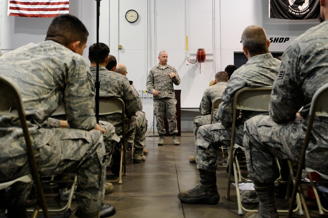 U.S. Air National Guard Command Chief Master Sgt. James W. Hotaling speaks with 144th Fighter Wing's junior enlisted Airmen during an all call held at the Fresno Air National Guard Base July 13, 2014. Airmen were given the opportunity to interact with Chief Hotaling and ask him any questions they had about the Air Force and the Air National Guard.  (U.S. Air National Guard photo by Airman 1st Class Klynne Pearl Serrano/Released)