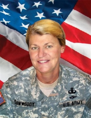 "U.S. Army Gen. Ann E. Dunwoody is shown cropped and pasted over a flag in an undated handout photo provided by the U.S. Army to the Associated Press in 2008. The Army claimed the portrait did not violate policy on photo manipulations because it did not ""misrepresent the facts or change the circumstances of an event."" The Associated Press disagreed and announced Nov. 14, 2008 that it would refuse to accept photos from the Department of Defense. (AP Photo/U.S. Army)"
