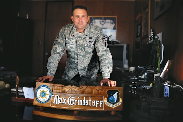 Chief Master Sgt. Maxwell Grindstaff poses for a photograph in his Harmon Hall office here July 16. He replaces soon-to-be-retired Chief Master Sgt. Stephen Ludwig as the Academy's command chief. (U.S. Air Force/Carol Lawrence)