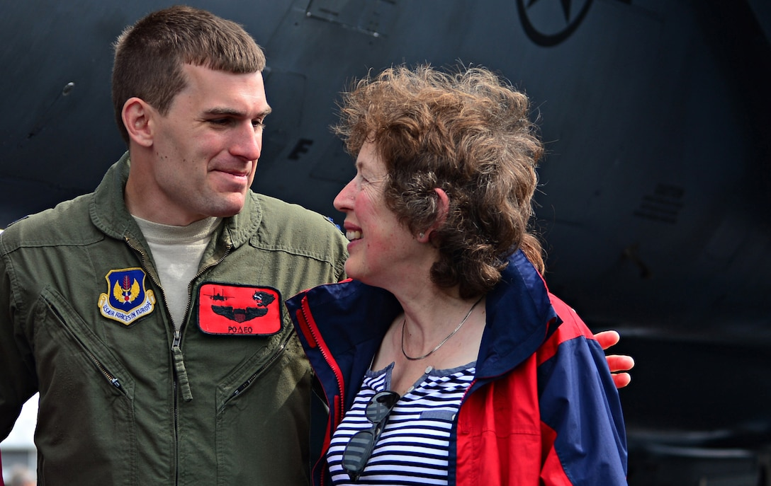 Capt. Tom Meyers, 494th Fighter Squadron F-15E Strike Eagle instructor pilot, speaks with a spectator about the aircraft during a public access showing at Farnborough International Airshow, England, July 19, 2014. The presence of military aircraft and their crew demonstrate U.S. industry ability to produce the type of equipment critical to the success of current and future military operations. (U.S. Air Force photo by Airman 1st Class Erin O'Shea/Released)