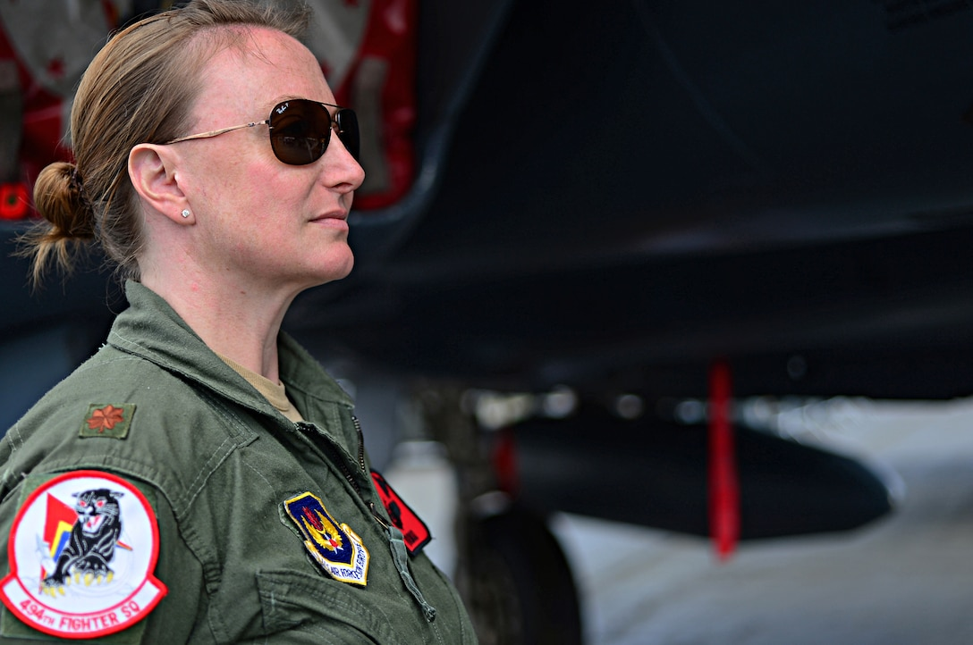 Maj. Claire Lundberg, 494th Fighter Squadron F-15E Strike Eagle weapons systems officer, stands in front of an F-15E Strike Eagle at Farnborough International Airshow, England, July 18, 2014. By participating in this U.K.-sponsored event, the U.S. demonstrates partnership and strong ties with the U.K., NATO, and Europe. (U.S. Air Force photo by Airman 1st Class Erin O'Shea/Released)