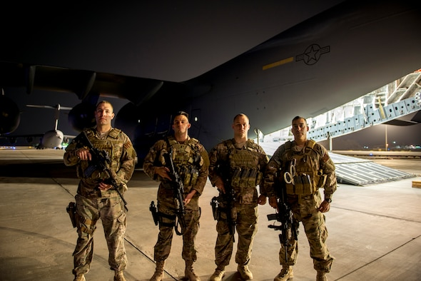 Airmen from the 386th Expeditionary Security Forces Squadron fly away security team prepare for a mission on a U.S. Air Force C-17 Globemaster III June 29, 2014 at an undisclosed location in Southwest Asia. The Airmen are deployed from around the country in support of Operation Enduring Freedom (U.S. Air Force photo by Staff Sgt. Jeremy Bowcock)