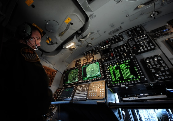 Maj. Brad Weber checks a screen that displays diagnostic information May 7, 2014, at Dyess Air Force Base, Texas. The IBS is a combination of three different upgrades, which includes a Fully Integrated Data Link, a Vertical Situation Display upgrade, and a Central Integrated System upgrade. The VSDU upgrades the B-1's forward cockpit by replacing two unsupportable, monochrome pilot and copilot displays with four multifunctional color displays, giving pilots more situational awareness data in a user-friendly format. Weber is a 337th Test and Evaluation Squadron, defensive weapons operator. (U.S. Air Force photo/Airman 1st Class Alexander Guerrero)