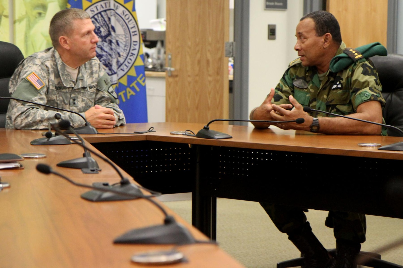 Maj. Gen Timothy Reisch, adjutant general of the South Dakota National Guard, meets with Col. Adolf Jardim, deputy commander of the Suriname Armed Forces, during the Reserve Forces Subject Matter Expert Exchange at Camp Rapid, S.D., July 11, 2014.
