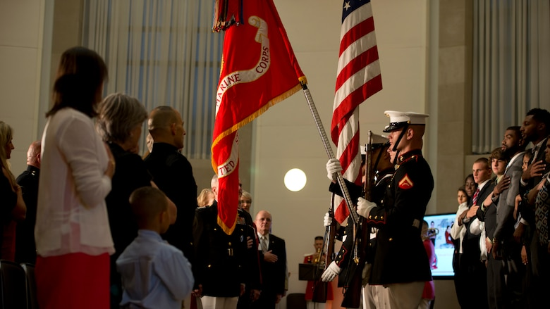 Color Guard Marines from Marine Barracks Washington present military honors for Commandant of the Marine Corps Gen. James F. Amos during the start of the Marine Corps Scholarship Foundation announcement ceremony hosted at the Ronald Reagan building in Washington, July 15, 2014. Since 1962 the Marine Corps Scholarship Foundation has awarded more than 30,00 scholarships valued at more than 80 million dollars.