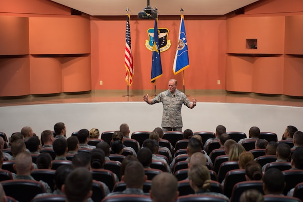 Chief Master Sgt. of the Air Force James A. Cody speaks to Airmen during an Airmen's Call July 11, 2014, on Travis Air Force Base, Calif. During his three-day visit, Cody discussed the future of the Air Force and force management challenges with Travis AFB Airmen. (U.S. Air Force photo/Ken Wright)