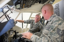Tech Sgt. Kenneth Kent, right, shows Chief Master Sergeant of the Air Force James A. Cody the inside of a C-17 Globemaster III simulator July 10, 2014, on Travis Air Force Base, Calif. During his tour of the 60th Air Mobility Wing, 621st Contingency Response Wing and the 349th Air Mobility Wing, Cody discussed improvements of the enlisted performance report, and the important role of frontline supervisors have in making the evaluation process one that helps all Airmen develop their potential. (U.S. Air Force photo/Ken Wright)