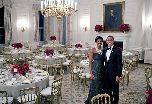 President Barack Obama and First Lady Michelle Obama pose in the State Dining Room of the White House before the Governors dinner, Feb. 22, 2009.