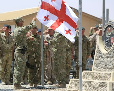 Georgian soldiers, with the Georgian contingent to Afghanistan, participate in the Georgian Flag Lowering ceremony aboard Camp Leatherneck, Helmand province, Afghanistan, July 15, 2014. The lowering of the Georgian Flag over Camp Leatherneck formally concludes the country's participation in Regional Command (Southwest), since 2004. (Official U.S. Marine Corps photo by Sgt. Dustin D. March/Released)