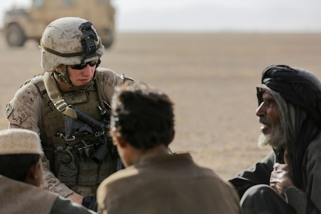 U.S. Marine Cpl. Justin Hinckley, a team leader with Weapons Company, 1st Battalion, 2d Marine Regiment, talks to a local family of the Washer district during a security patrol in Helmand province, Afghanistan on July 16, 2014. Patrols are conducted to disrupt enemy operations against Bastion- Leatherneck Complex. (Official U.S. Marine Corps photo by Cpl. John A. Martinez Jr. / Released)