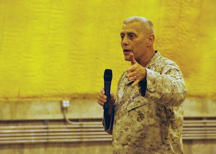 Assistant Commandant of the Marine Corps Gen. John M. Paxton Jr. speaks to Marines and sailors during a town hall meeting aboard Camp Leatherneck, Helmand province, Afghanistan, July 18, 2014. During the meeting, Gen. Paxton discussed the restructuring of the Corps, how Marines will reset into peacetime as a crisis response force, as well as the integration of women into ground combat jobs.