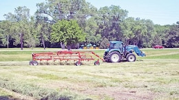 A local farmer tends to some hay on leased land at Fort Riley through the Agriculture Program, which allows unused land to be leased out for use to grow hay and crops to benefit the local community and Fort Riley.