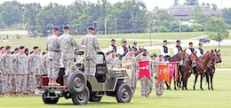 """Maj. Gen. Paul E. Funk II, commanding general, 1st Inf. Div. and Fort Riley; Col. Anthony """"Andy"""" Munera; and Col. James F. Reckard III conduct an inspection of the troops June 25 during a change of command ceremony for the 4th MEB, 1st Inf. Div., at Fort Leonard Wood, Mo. Inspection of the troops allows the new leader to see his formation before taking command. Munera took command of the brigade from Reckard during the ceremony."""