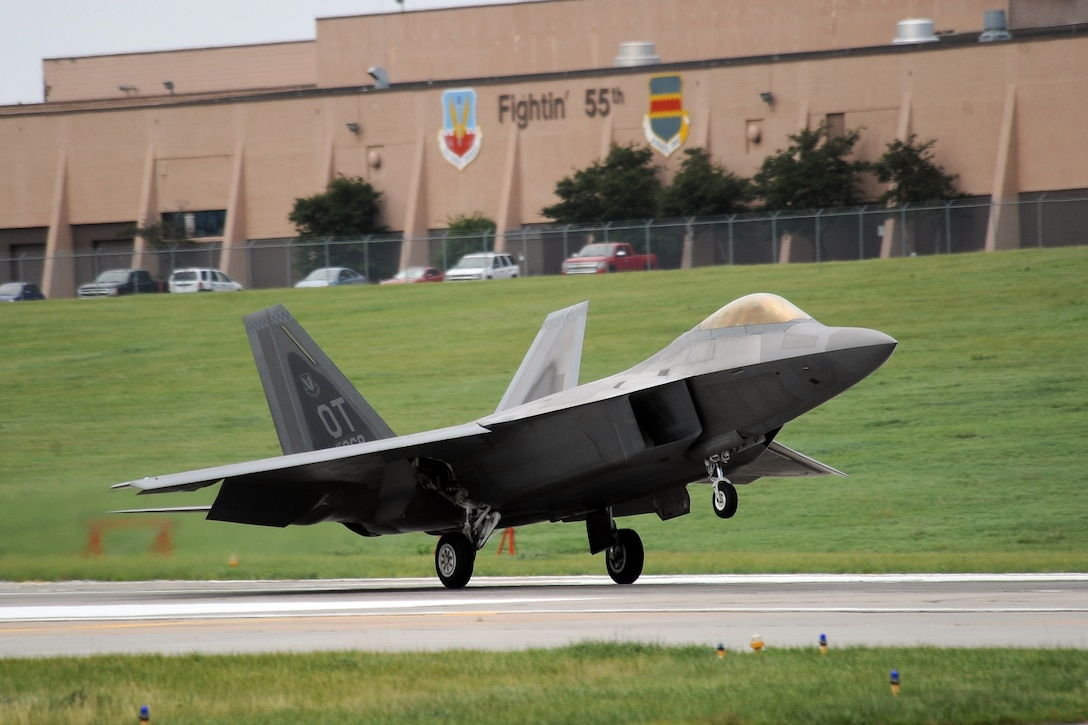 An F-22 Raptor with the F-22 Demo Team, lands on the Offutt Air Force Base, Nebraska runway following its performance at the 2014 Defenders of Freedom Open House and Air Show July 19.  The open house attracted record numbers of people from around the Omaha-metro area.  (U.S. Air Force photo by Josh Plueger/Released)