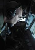 Tech. Sgt. Chris McAlister operates refueling boom while in flight over Virginia July 18, 2014. McAlister is an air refueling technician and has been with the 756th Airlift Squadron for over 23 years. (U.S. Air Force photo/ Senior Airman Nesha Humes)