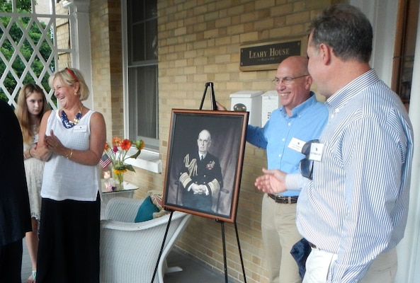 Navy Vice Adm. Kurt W. Tidd and members of the Leahy family unveil a portrait of Fleet Adm. William D. Leahy July 17, 2014, during a ceremony renaming the house in honor of the highest-ranking officer from World War II. DoD photo by Jim Garamone
