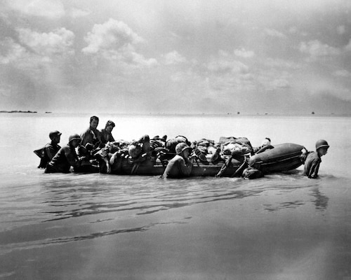 Marines wounded during the landing on Tarawa in November 1943 are towed out on rubber boats to larger vessels that will take them to base hospitals. Marine Corps photo